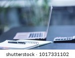 office workplace with laptop... | Shutterstock . vector #1017331102