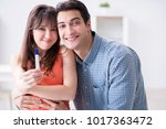 wife and husband looking at... | Shutterstock . vector #1017363472