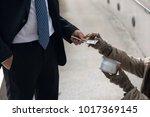 business man giving one dollar... | Shutterstock . vector #1017369145