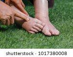 doctor assessing a elderly... | Shutterstock . vector #1017380008