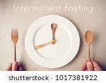 white plate with spoon and fork ... | Shutterstock . vector #1017381922