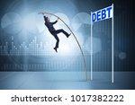 businessman pole vaulting over...   Shutterstock . vector #1017382222