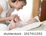 joyful mother playing and doing ... | Shutterstock . vector #1017411352