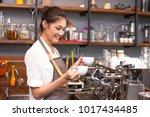 asian barista woman making... | Shutterstock . vector #1017434485