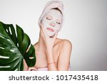 a woman with a towel on her... | Shutterstock . vector #1017435418