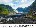 valley between mountains with a ... | Shutterstock . vector #1017477625