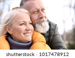 happy mature couple outdoors | Shutterstock . vector #1017478912