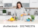 young woman preparing tasty...   Shutterstock . vector #1017481576