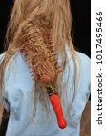 Small photo of the comb that got entangled in the hair