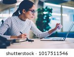 concentrated female designer in ...   Shutterstock . vector #1017511546