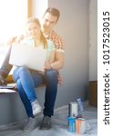 portrait of young couple moving ... | Shutterstock . vector #1017523015