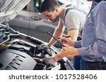 a man mechanic and woman... | Shutterstock . vector #1017528406