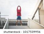sportman in red hood doing... | Shutterstock . vector #1017539956