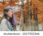 beautiful young woman walking... | Shutterstock . vector #1017552346