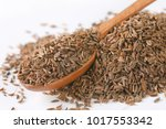 pile and spoon of caraway seeds ... | Shutterstock . vector #1017553342