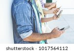 group of people using... | Shutterstock . vector #1017564112