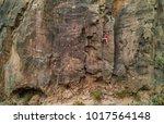 strong man climbing a rock wall ...   Shutterstock . vector #1017564148