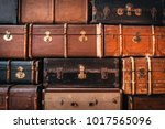 vintage suitcases stacked in a... | Shutterstock . vector #1017565096
