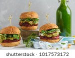 vegan beet burgers with... | Shutterstock . vector #1017573172