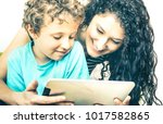 young mother having fun with...   Shutterstock . vector #1017582865