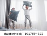 happy kids playing in white... | Shutterstock . vector #1017594922