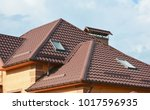 metal roof with modern house... | Shutterstock . vector #1017596935