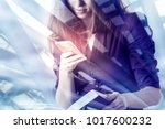 businesswoman using smartphone... | Shutterstock . vector #1017600232