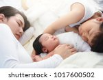 beautiful mother and daughter... | Shutterstock . vector #1017600502