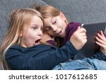 2 girls are amazed by... | Shutterstock . vector #1017612685