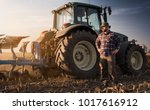young farmer working during the ... | Shutterstock . vector #1017616912