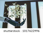 euro coins float over a robot... | Shutterstock . vector #1017622996
