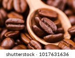 brown roasted coffee beans ... | Shutterstock . vector #1017631636