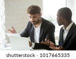 multi ethnic colleagues having... | Shutterstock . vector #1017665335