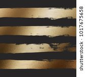 golden paint strokes on black... | Shutterstock .eps vector #1017675658