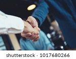 business people shaking hands... | Shutterstock . vector #1017680266