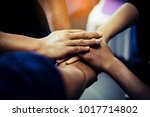 group of people joining their... | Shutterstock . vector #1017714802
