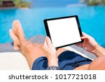 Man Using Tablet On Vacation By ...