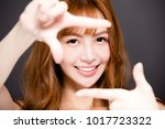 young woman making frame with... | Shutterstock . vector #1017723322