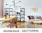 pink chair at wooden table with ...   Shutterstock . vector #1017725992