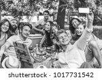 group of friends making a... | Shutterstock . vector #1017731542