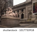 Small photo of New York , New York, USA. Febuary 1, 2018. One of the lions, Patience and Fortitude, that adorn the steps to the New York Public Library in Manhattan, New York