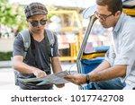traveller asking directions... | Shutterstock . vector #1017742708