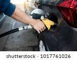 man refilling gasoline oil with ...   Shutterstock . vector #1017761026