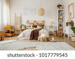 brown blanket on bed in... | Shutterstock . vector #1017779545