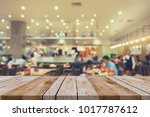 empty brown wooden table and... | Shutterstock . vector #1017787612