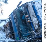 Small photo of Moscow region, Russia - February, 2, 2018: the truck turned over in a ditch on a snow-covered road in Moscow region, Russia