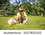 boy with a basket of easter... | Shutterstock . vector #1017832102
