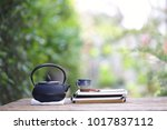 black vintage teapot and... | Shutterstock . vector #1017837112