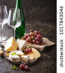 piece of camembert cheese with... | Shutterstock . vector #1017843046
