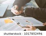 people working in office | Shutterstock . vector #1017852496